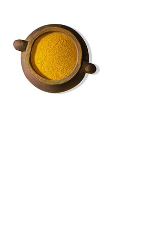 Turmeric powder and turmeric isolated on white background, indian spice,healthy seasoning ingredient for vegan cuisine concept. Top view