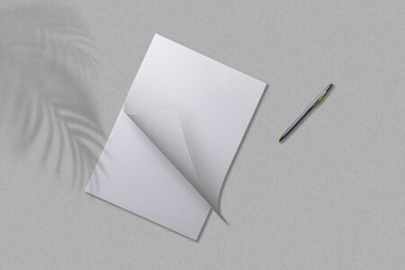 Open notebook and pen on a gray table. Top view. Archivio Fotografico