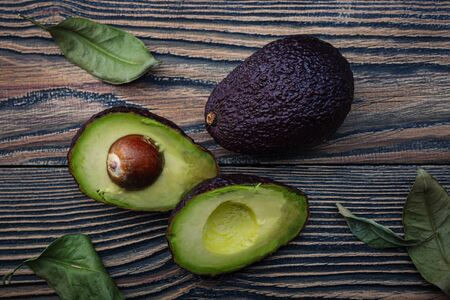 Fresh ripe avocado on an old wooden table. Top view.