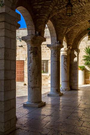 first miracle: KFAR KANNA, ISRAEL - OCTOBER 13: Colonnade of Wedding church in Kfar Kanna, Israel on October 13, 2015
