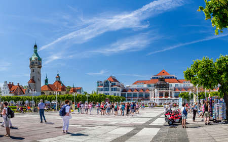 6 people: SOPOT, POLAND - JUNI 6 : People strolling on the square before restaurant of the Sheraton Hotel in Sopot, Poland on Juni 6, 2015