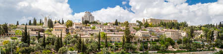 jewish houses: JERUSALEM, ISRAEL -  APRIL 4: Panoramic view of the Yemin Moshe neighborhood, Montefiore Windmill from Mount Zion, outside the walls of the Old City in Jerusalem, Israel on April 4, 2015