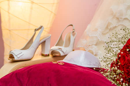 kippah: Jewish wedding - Kippah of groom and wedding rings on a red velvet pillow Stock Photo