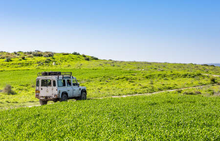 shalom: NEVE SHALOM, ISRAEL - JANUARY 31: SUV Land Rover Defender, rides on the country road among meadows in Neve Shalom, Israel on January 31, 2015