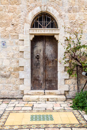 Old iron double door with half round transom on one of the streets of Jerusalem, Israel