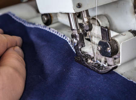 stitching machine: Work at the sewing machine, stitching fabric edge at overlock