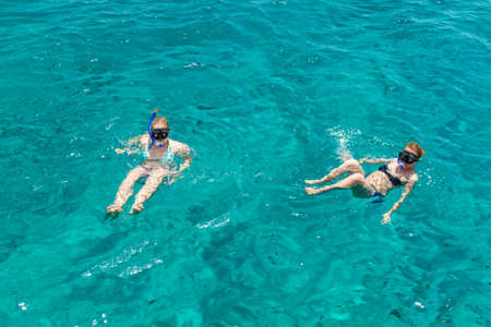 diving mask: Two girls in diving mask swimming in the Red Sea in Eilat, Israel Stock Photo