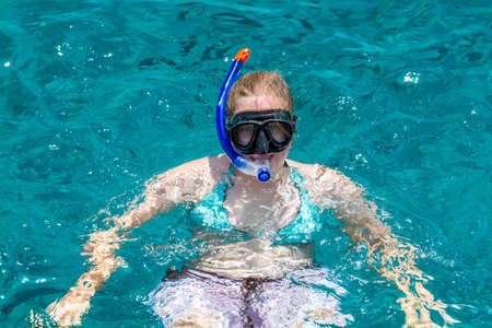diving mask: Girl in diving mask swimming in the Red Sea in Eilat, Israel