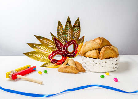 book of esther: Jewish holiday of Purim. Hamantaschen cookies, gragger and carnival mask