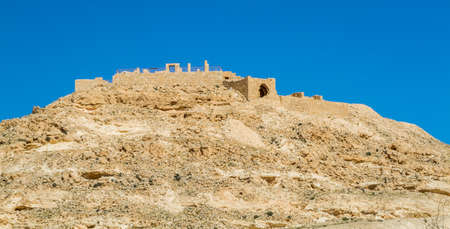 nabatean: The desert landscape, ruins of the ancient city on hill. Avdat, Nabatean Town on the ancient spice route in the Negev Desert, Israel Stock Photo