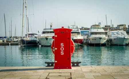 lifebuoy: LIMASSOL, CYPRUS - SEPTEMBER 7: Red safety hydrant station, fire extinguisher cabinet and lifebuoy holder, in Limassol marina, Cyprus on September 7, 2015