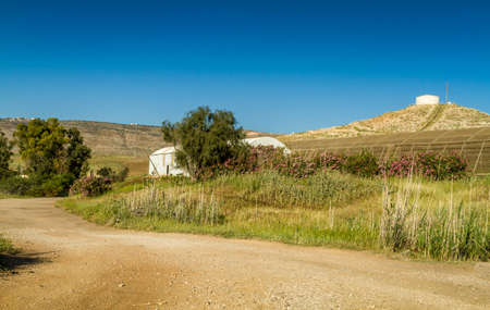 kibbutz: Rural landscape, water storage tank on a hill near the agricultural kibbutz in Israel