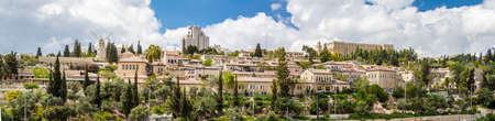jewish home: JERUSALEM, ISRAEL -  APRIL 4: View of the Yemin Moshe neighborhood, Montefiore Windmill from Mount Zion, outside the walls of the Old City in Jerusalem, Israel on April 4, 2015