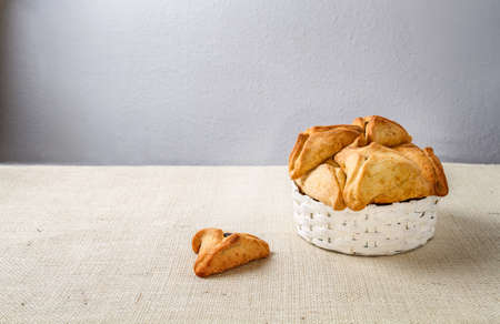 esther: Jewish holiday of Purim. Hamantaschen cookies on canvas background Stock Photo