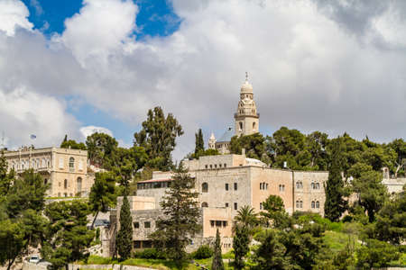 institute is holy: JERUSALEM, ISRAEL - APRIL 4: The Dormition Abbey and the Institute for the Study of the Bible, outside the walls of the Old City in Jerusalem, Israel on April 4, 2015