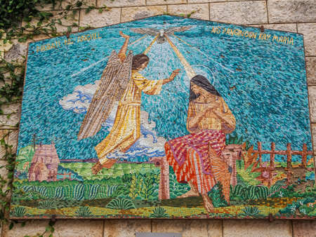 annunciation of mary: NAZARETH, ISRAEL - MARCH 24: Mosaic panel depicting the Virgin Mary and Angel, Basilica of the Annunciation in Nazareth, Israel on March 24, 2016
