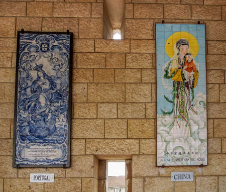 annunciation of mary: NAZARETH, ISRAEL - MARCH 24: Panels of glazed tiles depicting the Virgin Mary and Angel, Basilica of the Annunciation in Nazareth, Israel on March 24, 2016