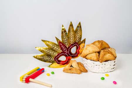 hamantaschen: Jewish holiday of Purim. Hamantaschen cookies, gragger and carnival mask