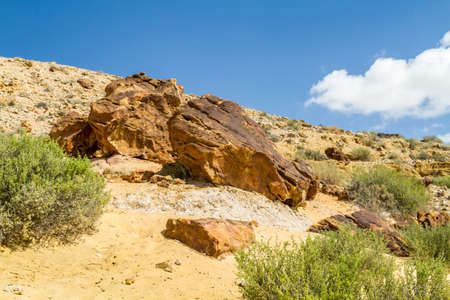 Boulders on the hill in Makhtesh Gadol or Large Crater, nature reserve in Negev desert, Israel Stock Photo