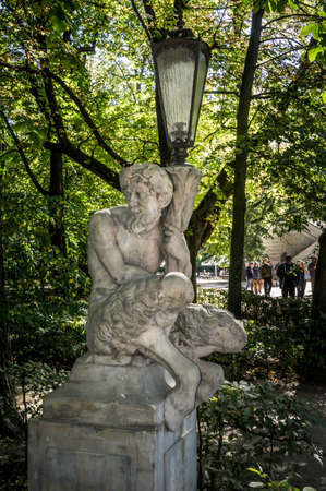 WARSAW, POLAND - SEPTEMBER 27: Garden Sculpture of Satyr with lantern, Lazienki Park or Royal Baths Park in Warsaw, Poland on September 27, 2016