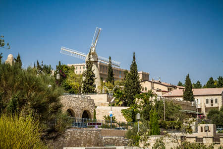 jewish home: The Montefiore Windmill opposite the western city walls of the Old City in Jerusalem, Israel Stock Photo