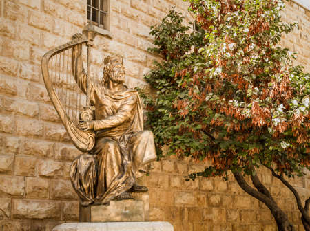 JERUSALEM, ISRAEL - OCTOBER 5: The statue of King David playing the harp near entrance to his tomb on Mount Zion in Jerusalem, Israel on October 5, 2016