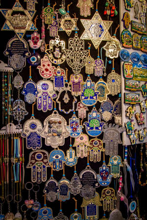 magen: The Hamsa - palm-shaped amulet and Magen David - star of David, souvenirs in gift shop on Arab market in Old City of Jerusalem, Israel