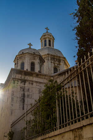 Roman Catholic Church of the Condemnation and Imposition of the Cross, view from Via Dolorosa street in the sunset light in the Old City of Jerusalem, Israel. Stock Photo