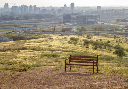 Bench on a hilltop overlooking the Beer Sheva city in the Negev desert, Israel