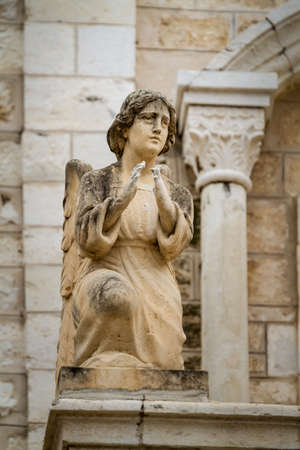 first miracle: Stone sculpture of angel in the facade of the Church Of The First Miracle, the Catholic Wedding Church in Cana of Galilee, Israel Stock Photo