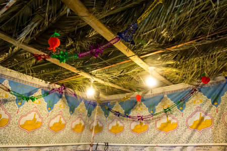 succos: Fabric sukkah decorated with printed pattern and hebrew text of blessing: Grant peace everywhere goodness and blessing, Grace, lovingkindness and mercy to us and unto all Israel, Your people. Night