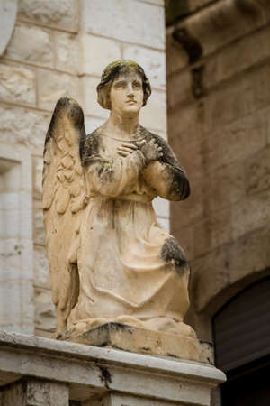 Stone sculpture of angel in the facade of the Church Of The First Miracle, the Catholic Wedding Church in Cana of Galilee, Israel Stock Photo