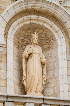 first miracle: Sculpture in niche in the facade of the Church Of The First Miracle, the Catholic Wedding Church in Cana of Galilee, Israel