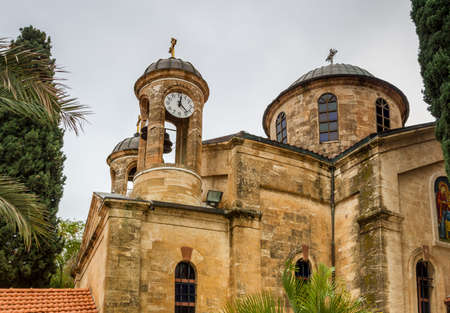 The Cana Greek Orthodox Wedding Church in Cana of Galilee, Kfar Kana in winter cloudy day, Israel. View of the domes, close-up