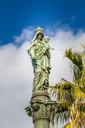 Column of Holy Virgin Mary, Stella Maris Madonna statue, opposite to Stella Maris Monastery in Haifa, Israel. Close-up Stock Photo
