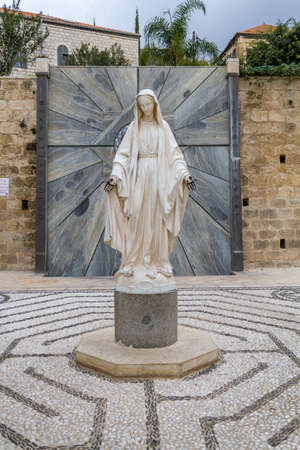 annunciation of mary: Statue of Virgin Mary in courtyard of the Basilica of the Annunciation in Nazareth or Church of the Annunciation, Israel Stock Photo
