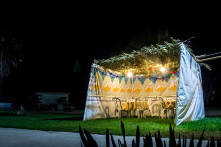 Fabric sukkah decorated with printed pattern and hebrew text of blessing: Grant peace everywhere goodness and blessing, Grace, lovingkindness and mercy to us and unto all Israel, Your people. Night