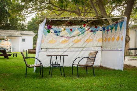 Fabric sukkah decorated with printed pattern and hebrew text of blessing: Grant peace everywhere goodness and blessing, Grace, lovingkindness and mercy to us and unto all Israel, Your people. Stock Photo