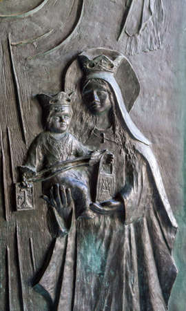 embossing: Part of door with embossing, Mary and Baby Jesus carved into the door in Stella Maris Monastery in Haifa, Israel Stock Photo