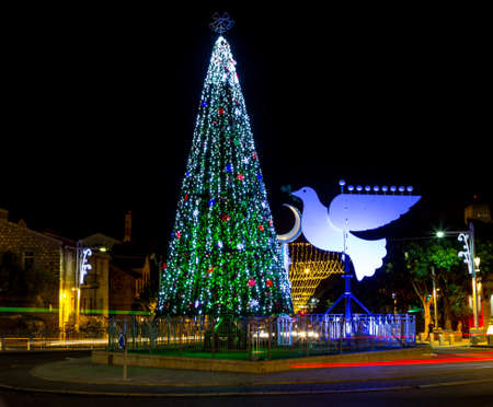 Christmas tree and Hanukkah menorah in the form of a dove in Haifa, Israel