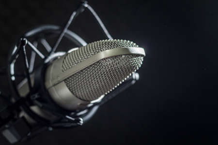 Microphone and audio console on dark background