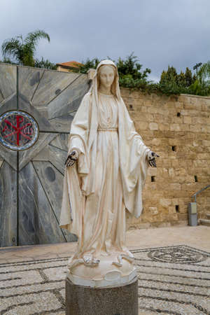 annunciation of mary: NAZARETH, ISRAEL - DECEMBER 11: Statue of Virgin Mary in courtyard of the Basilica of the Annunciation or Church of the Annunciation in Nazareth, Israel on December 11, 2016