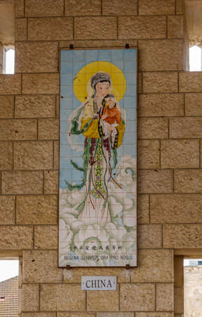annunciation of mary: NAZARETH, ISRAEL - DECEMBER 11: Panels of glazed tiles depicting the Virgin Mary with Child Jesus, Basilica of the Annunciation in Nazareth, Israel on December 11, 2016