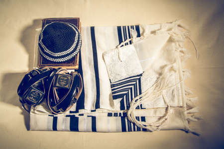 sephardi: Jewish ritual objects, Talit with hebrew inscription: And brought us to Zion in joy. Kippah, Tefillin with a hebrew inscription: The arm tefillin and The head tefillin and Siddur - jewish prayer book