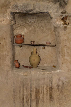 holy jug: The clay jugs, replica of old ewers, earthenware on shelf in wall niche in Nazareth Village, Israel. Ancient Holy Land Stock Photo