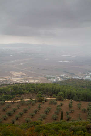 View of the Jezreel Valley in fog in winter cloudy day from Muhraqa on Mount Carmel in Lower Galilee, Israel
