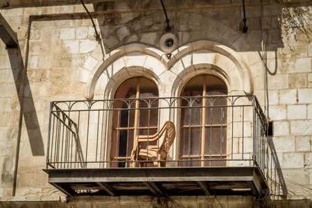 jewish houses: The balcony and arched windows in the white stone house in Jerusalem, Israel Stock Photo