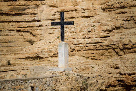 Cross near the monastery of Saint George of Choziba in Judaean Desert in the Holy Land, Israel