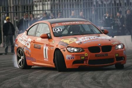 pista: drift with orange car Editorial