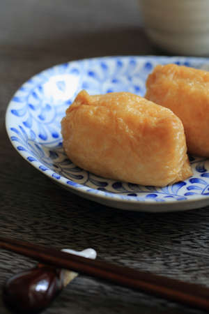 bean curd: Japanese sushi rice wrapped in fried bean curd Stock Photo